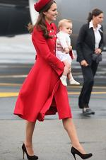 <p>Lady in red, Catherine, Duchess of Cambridge wears Catherine Walker as she steps off the plane at Wellington Military Terminal. Picture: Getty</p>