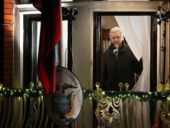 Home ... Wikileaks founder Julian Assange parts the curtains as he starts to speak from a balcony at the Ecuadorean embassy.