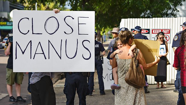 Protestors lunged out at the private car of Immigration Minister's Scott Morrison as he left a press conference at the Police HQ based in the NAB building in Darwin city. Picture: Michael Franchi.