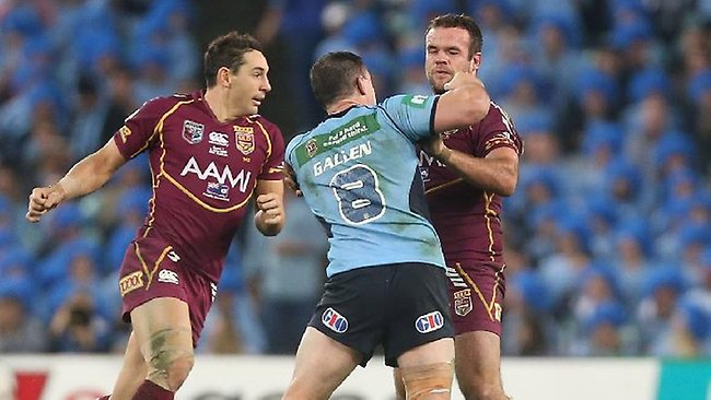 Paul Gallen lands a punch on Nate Myles as Billy Slater offers support.