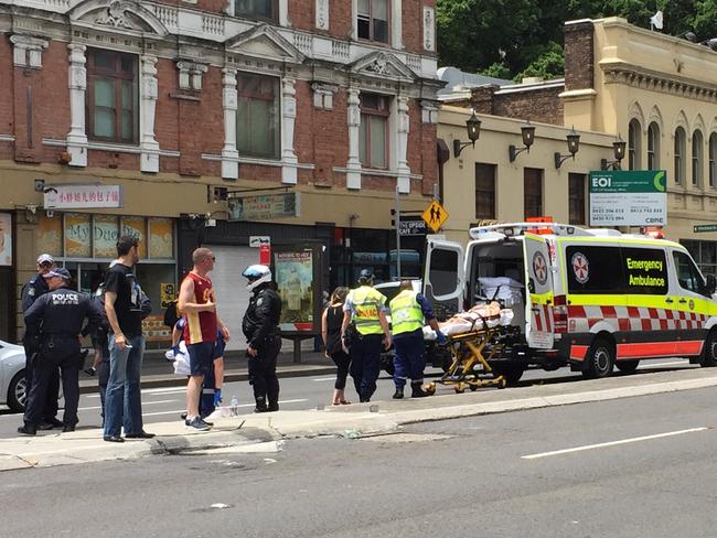 The injured woman is loaded on to a stretcher. Picture: Ian Paterson
