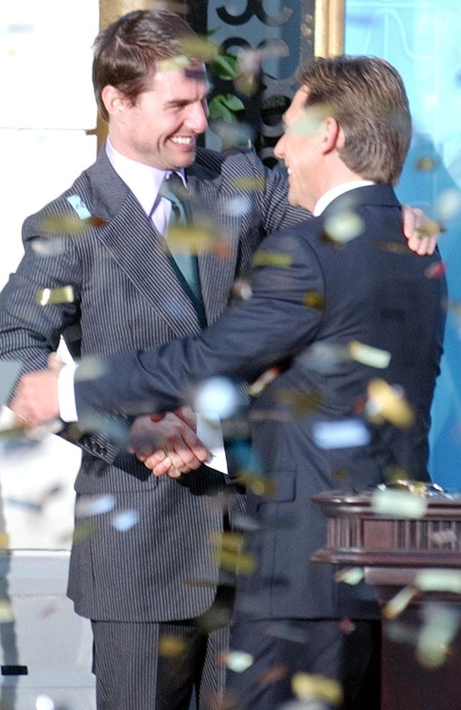 Close friends ... Tom Cruise embraces David Miscavige, the Scienology Church's President.
