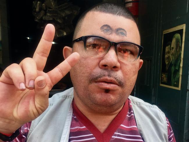 A Hugo Chavez fan with the former leader's eyes tattooed on his head. Picture: Courtesy of the ABC