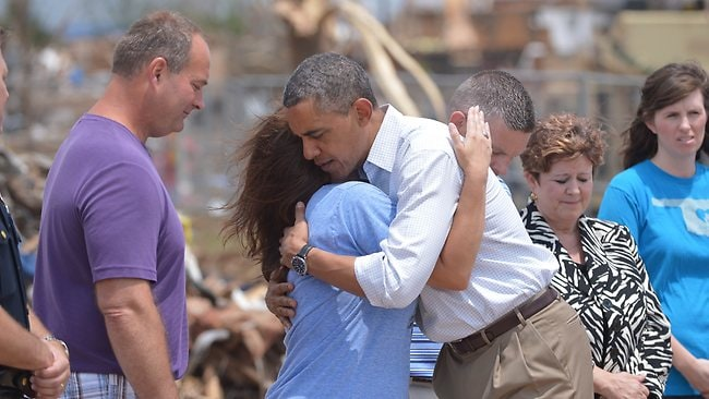 US President Barack Obama greeted by survivors as he tours the tornado-hit town of Moore, Oklahoma. Mr Obama is in the Oklahoma City area to survey damage from the tornado which struck a week ago and meet with victims and first responders. Picture: AFP