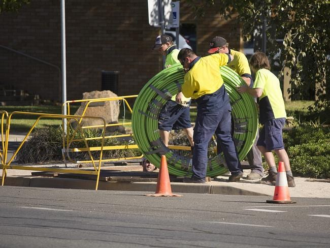 NBN workers roll out cabling.