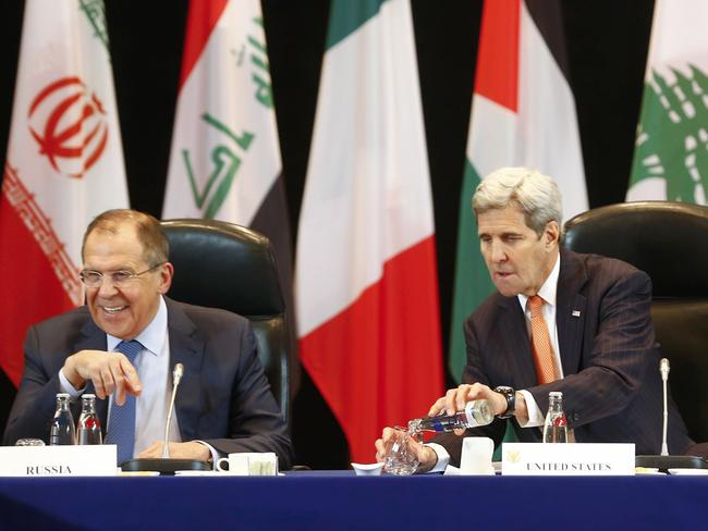 Global meeting ... US Secretary of State John Kerry, right, and Russia's Foreign Minister Sergei Lavrov lead the International Support Group for Syria (ISSG) meeting in Munich. Picture: AFP