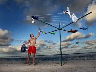 Iconic Antipodean installation by Andrew Baines. Henley SLSC members pictured at Henley Beach hanging their washing on Hills Hoist's. Pictured: Simon Mitris from Henley SLSC.