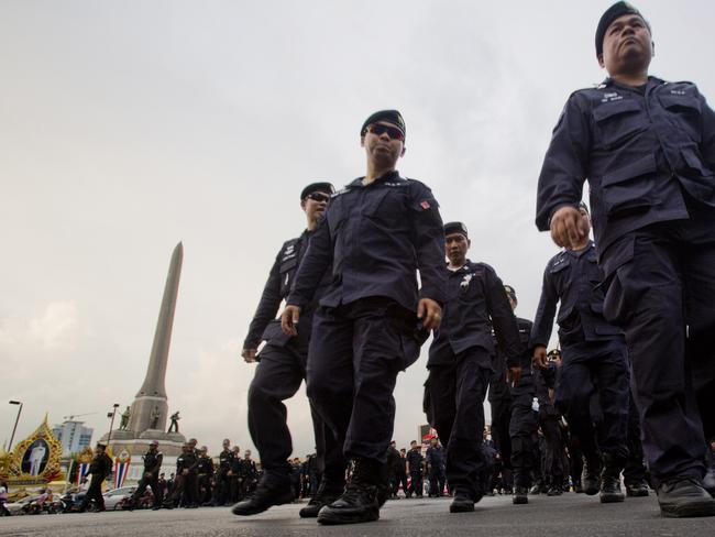 Protests banned ... Thai police officers leave Victory Monument in Bangkok. Picture: AP