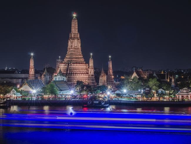 Appreciating the night lights of Wat Arun in Bangkok.
