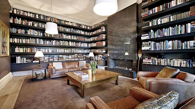 VIZARD'S ST KILDA MANSION: The library has a rustic feel with brown carpet and leather lounges.