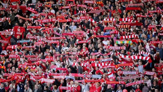 Never forgotten ... Liverpool fans sing Y <i>ou'll Never Walk Alone </i>during the Hillsborough memorial service marking the 25th anniversary of the disaster at Anfield stadium on April 15 this year.