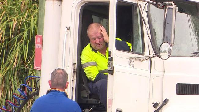 A truck driver is dead after he was struck by a another truck on Vardys Road, Kings Park. The other truck driver (pictured) is said to be devastated. Picture: Top Notch Video