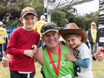 Action from the 2014 City to Surf for Activ. Sunday Times sports writer, Glen Quartermain with his kids after the race.