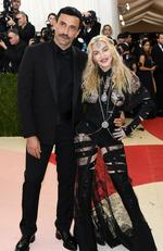 "Designer Riccardo Tisci (L) and Madonna attend the ""Manus x Machina: Fashion In An Age Of Technology"" Costume Institute Gala at Metropolitan Museum of Art on May 2, 2016 in New York City. Picture: Larry Busacca/Getty Images"