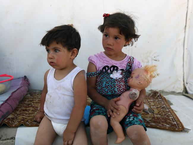 Syrian refugee Youmna, 4, and her brother Ammar, 3, outside their tent at a Syrian refugee camp in the eastern town of Marj in Bekaa valley, Lebanon, on Sunday. Photo: Bilal Hussein