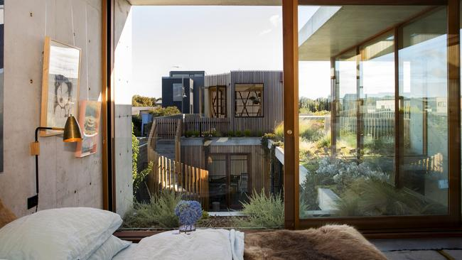 Masterful: The main bedroom in the Torquay house of concrete, which wraps three sides of a private garden. Supplied by Foxtel