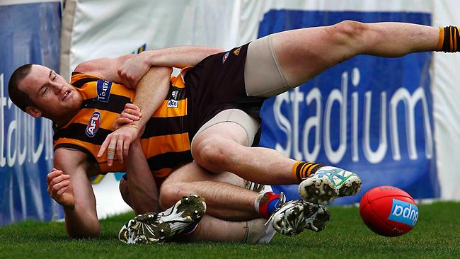 Jarryd Roughead is tackled by Jordan Roughead during the 3rd quarter of the Hawthorn vs Western Bulldogs match at Aurora Stadium, Launceston. Saturday July 20, 2013. Picture: Klein Michael