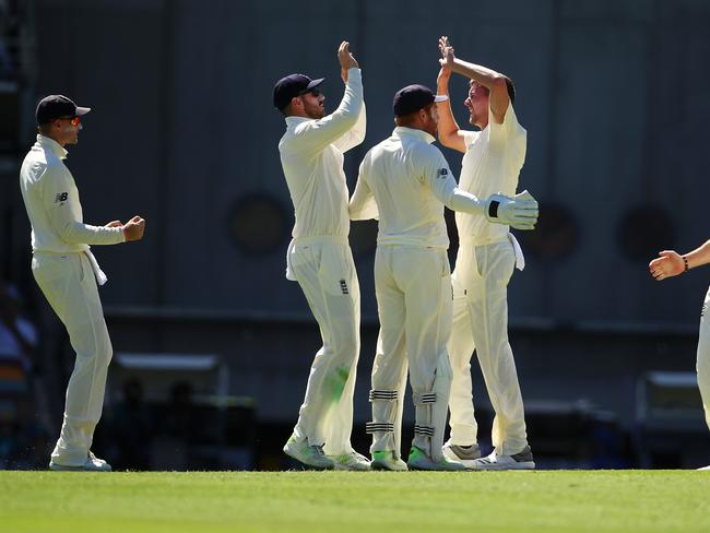 Jake Ball celebrates the wicket of David Warner.