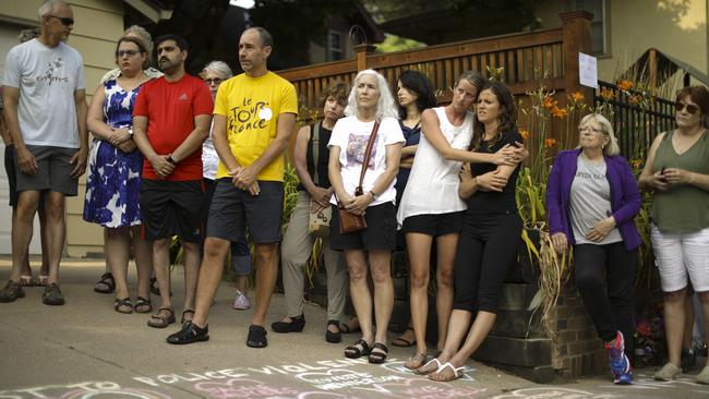 Neighbours at a vigil to remember Justine outside her home yesterday. Picture: Jeff Wheeler/Star Tribune