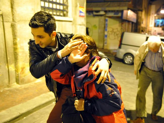 Attacks ... the attack allegedly targeted German tourists in the historic Sultanahmet district. They were escorted back to their hotel in Istanbul after the attack. Picture: AP Photo/Omer Kuscu