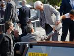 George Clooney helps his father Nick board a water-taxi in Venice, Italy on Friday, September 26th 2014. Picture: AP