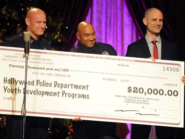 Scientology Celebrity Centre vice president Greg LaClaire (right) presents a US$20,000 cheque to Commander Captain Peter Zarcone and Sergeant Darrell Davis of the Hollywood area division of the LAPD last Christmas.