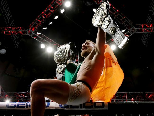 Conor McGregor with two title belts at UFC 205.