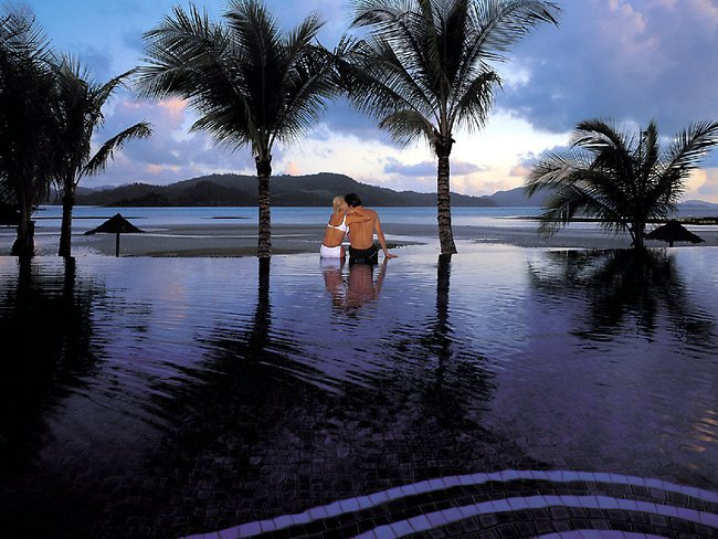 The Beach Club pool at sunset on Queensland's Hamilton Island. Picture: Supplied
