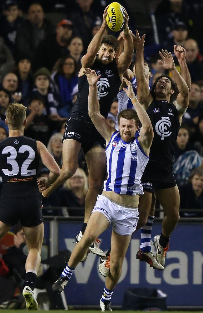 Jarrad Waite marks strongly over Kangaroo Lachie Hansen. Picture: Getty