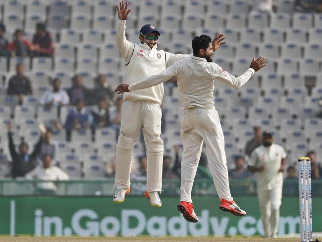 Ravindra Jadeja, right, and Karun Nair jump in air as they celebrate the dismissal of Joe Root.