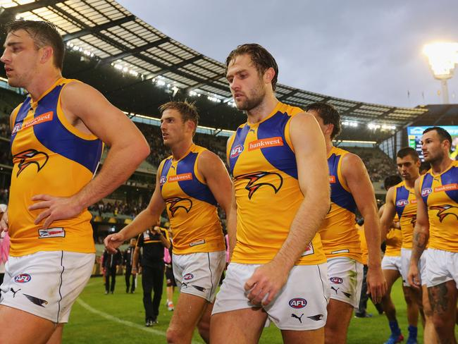 Eagles players were dejected after a loss to Richmond at the MCG in round three.
