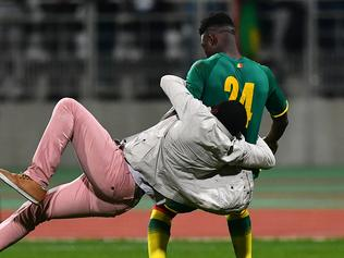 PARIS, FRANCE - MARCH 27: A pitch invader tackles Lamine Gassama of Senegal during the International Friendly match between the Ivory Coast and Senegal at the Stade Charlety on March 27, 2017 in Paris, France. (Photo by Dan Mullan/Getty Images)