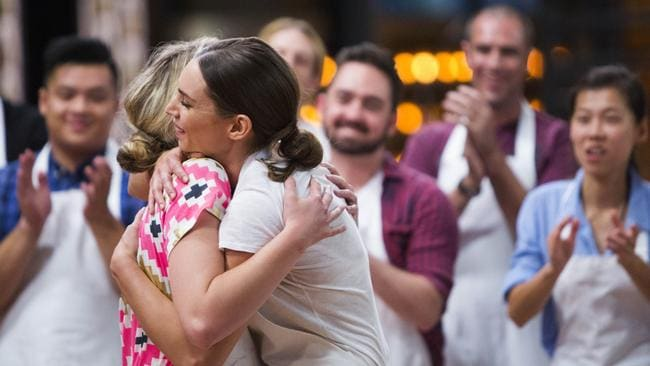 Relieved ... Sarah Todd (right) is congratulated by Georgia Hughes and the other contestants after winning her way back into MasterChef Australia.