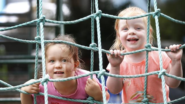 Olive and Lily, both 3, having fun climbing the cargo net to improve their balance and confidence at Civic Kindergarten Middle Park. Picture: David Caird