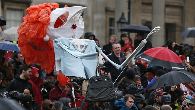 A huge puppet depicting former British Prime Minister Margaret Thatcher is seen during a party in central London's Trafalgar square, Saturday, April 13, 2013, to mark her death. (AP Photo/Lefteris Pitarakis)