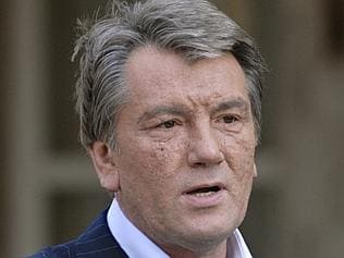 Faced death ... then-president Viktor Yushchenko still bore the scars of being poisoned in 2007. Picture: AP/Sergei Chuzavkov