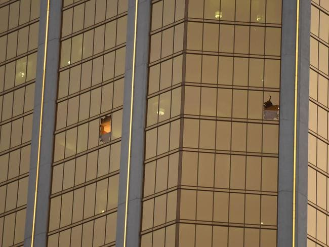 Paddock smashed two windows in his hotel suite which enabled him to fire on the crowd below. Picture: Robyn Beck/AFP