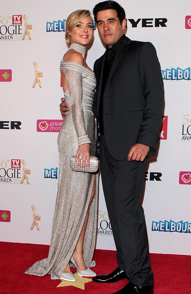 Jessica Marais and James Stewart arrive at the 2014 Logie Awards at Crown Palladium