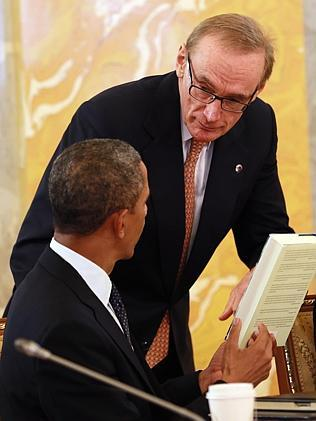 Bob Carr gives a book by Michael Fullilove to the US President Barack Obama at the second working meeting of G20 heads of state and government. Picture: ELLA PELLEGRINI