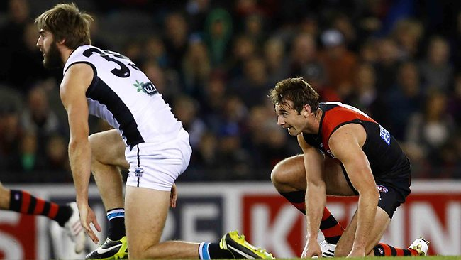 Jobe Watson after colliding heavily with Justin Westoff during the 1st quarter of the Essendon v Port Adelaide match at Etihad Stadium. Sunday July 7, 2013. Picture: Klein Michael