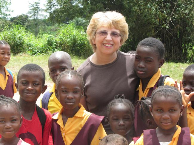 Ebola patient ... American missionary Nancy Writebol, with children in Liberia. Picture: AP