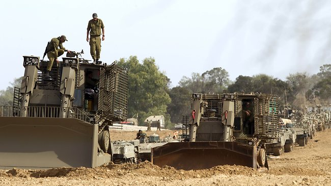 Israeli D9 bulldozers are stationed at the Israeli-Gaza Strip border. Picture: Jack Guez