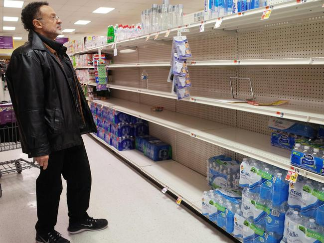 A shopper looks at the bottled water section at a supermarket ahead of the blizzard in Washington, DC. Picture: AFP/Mandel Ngan