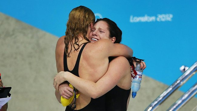 London Olympics 2012 - Swimming Day 3 - Women's 100m backstroke Final. Australia's Emily Seebohm in tears is consoled by Gemma Spofforth of Great Britain after missing out on the Gold finishing with Silver. Picture: Phil Hillyard