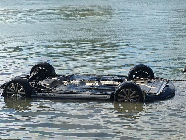The car rolled off a boat ramp into water after the young driver found fled the vehicle because of a spider. Picture: Stuart Cooper