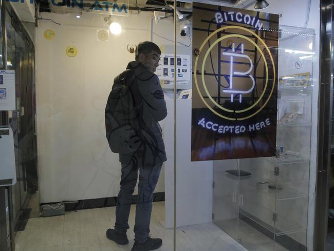 A man uses a Bitcoin ATM in Hong Kong this month. Picture: Kin Cheung