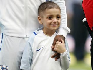 FILE - In this file photo dated Sunday, March 26, 2017, Bradley Lowery holds the hand of England's Jermain Defoe prior to the World Cup Group F qualifying soccer match between England and Lithuania at the Wembley Stadium in London, Great Britain. Lowery, a soccer mascot who struck up a close friendship with England striker Jermain Defoe after being diagnosed with a rare cancer and gained fans across the sport, has died aged 6, according to a family statement Friday July 7, 2017. (AP Photo/Kirsty Wigglesworth, FILE)
