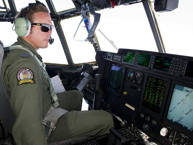 On duty ... Royal Australian Air Force pilot Flight Lieutenant Conan Brett pilots a RAAF C-130J Hercules aircraft in the search for Malaysia Airlines flight MH370.