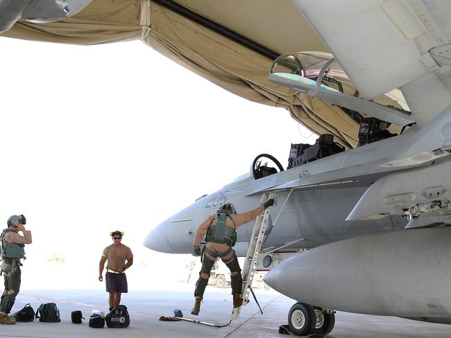 Australia gets involved ... Royal Australian Air Force (RAAF) aircrew disembark a RAAF F/A-18F Super Hornet aircraft after a mission in the Middle East. Picture: Supplied.