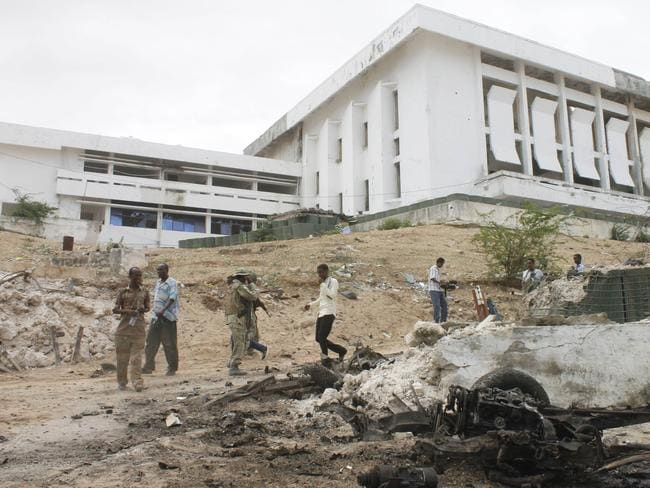 Seat of government... Somali army soldiers walk next to the Somali parliament. Picture: Mohamed Abdiwahab